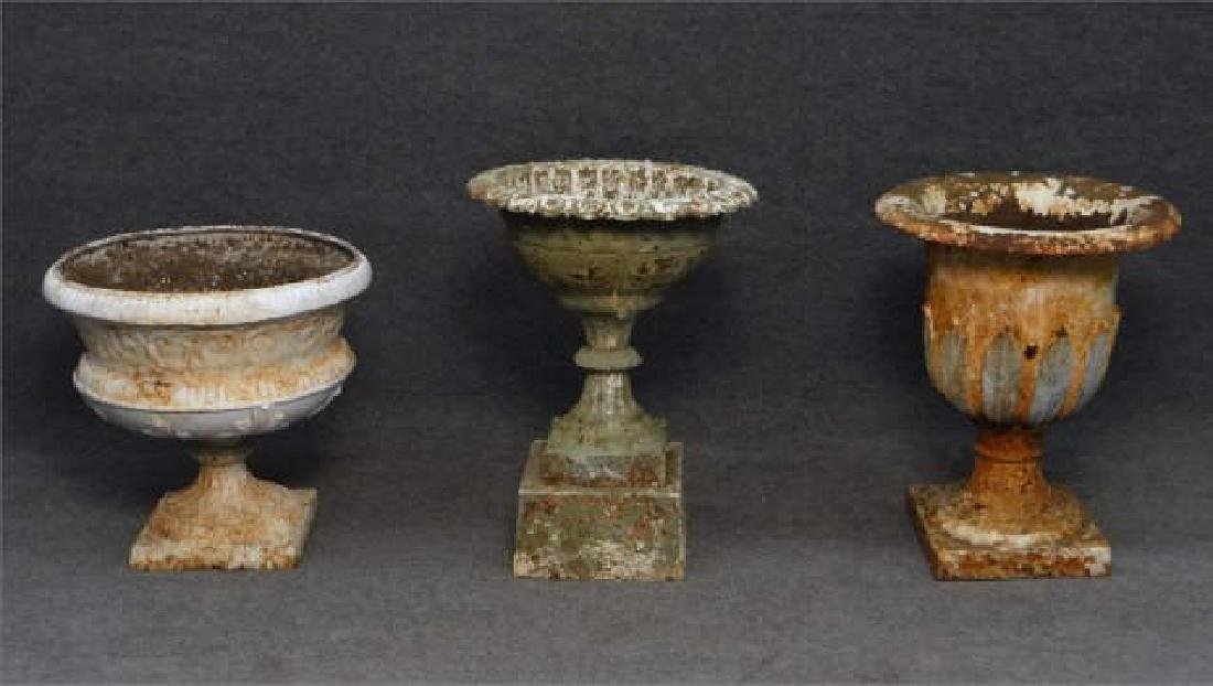 "3 CAST IRON GARDEN URNS: 20"", 24"" & 25"" TALL"