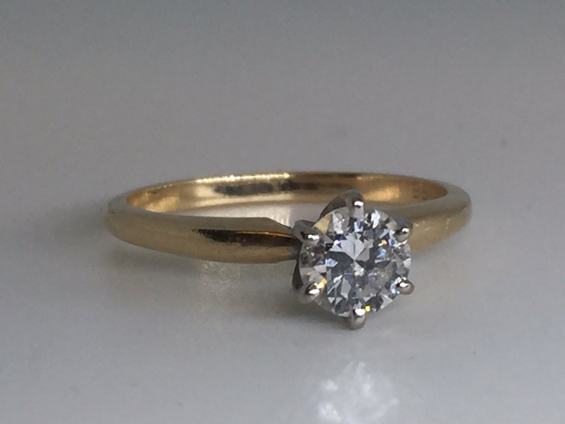 DIAMOND SOLITAIRE IN 14KT YELLOW GOLD 6 PRONG SET.