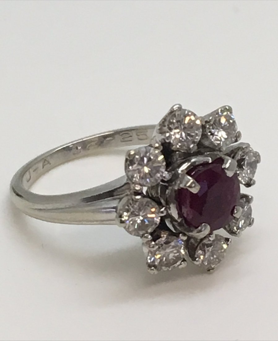 ROUND NATURAL RUBY W/ 8 BRILLANT CUT DIAMONDS