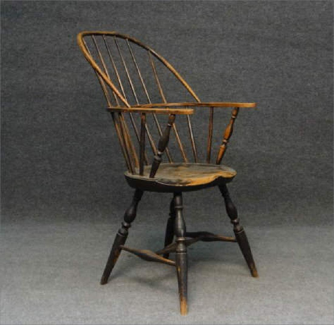 EARLY SACK BACK WINDSOR ARM CHAIR (CRACK IN BOW)