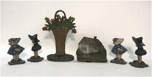 SIX CAST IRON DOOR STOPS, BASKET OF FLOWERS, B & H
