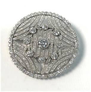 CIRCULAR DIAMOND BROOCH, APPROX. 8.5 TOTAL CARAT