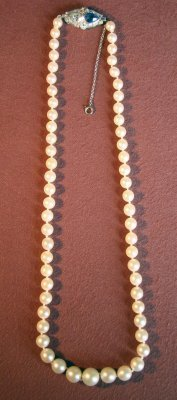 "23: 16"" Strand Of Graduated Pearls With Diamond & Sapph"