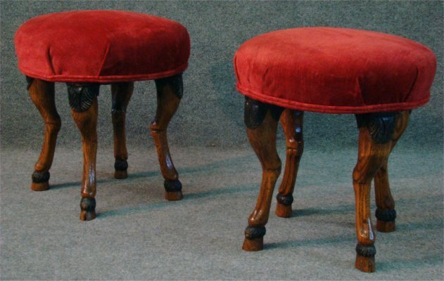 2: Two Upholstered Stools With Hoof Feet