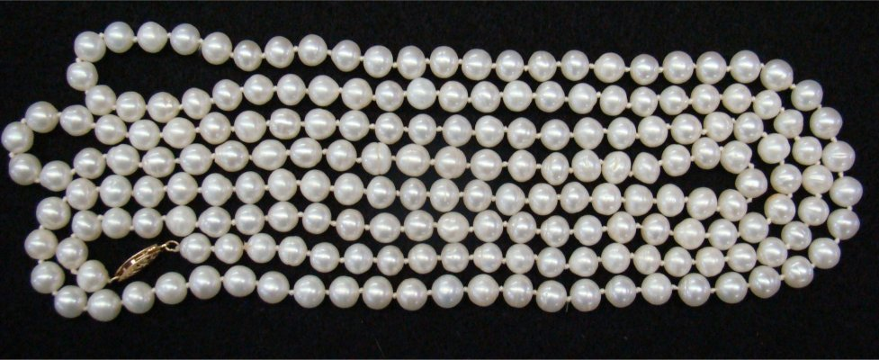 "Opera Length Strand Of Pearls, Approximately 55"" Long"