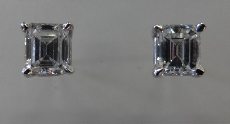 Pair Of Emerald Cut Diamond Stud Earrings,