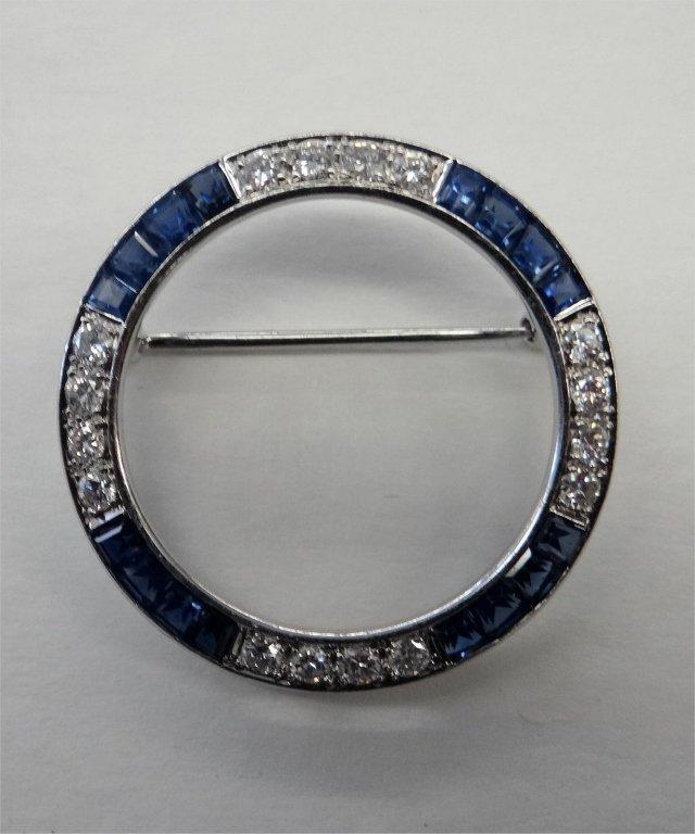 DIAMOND & SAPPHIRE CIRCLE PIN SET IN PLATINUM