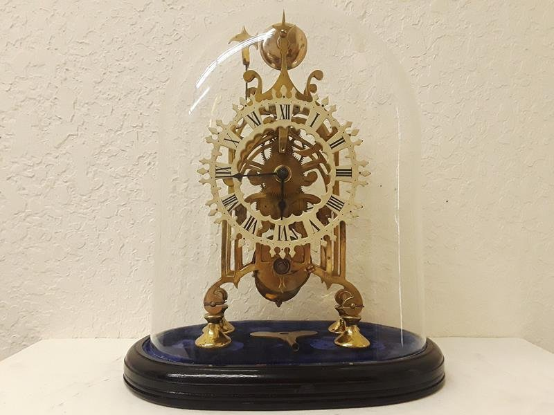 Skeleton Mantle Clock Running with Oval Glass Dome