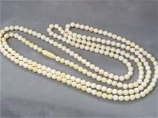 "115: 60"" Long Antique 7mm Round Ivory Bead Opera Length"