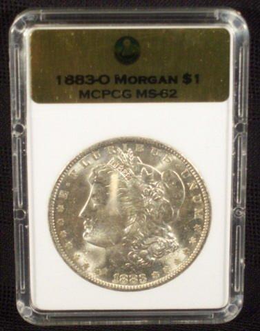 5A: 1883O Silver Morgan Dollar MCPCG Graded MS62