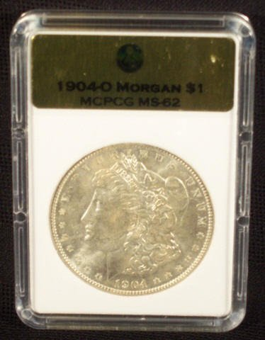 6: 1904O Silver Morgan Dollar MCPCG Graded MS62