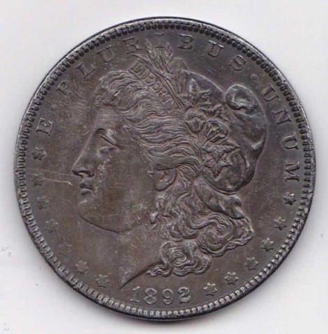 12: 1892 Silver Morgan Dollar