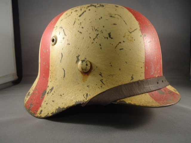 22: German World War II Army Medic M-40 Combat Helmet.