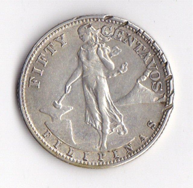 200: 1944 Filipinas 90% Silver Fifty Centavos Coin