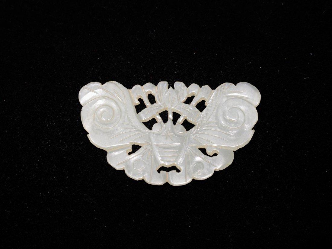 6: A Pale Celadon Jade Butterfly Pendant, Ming Dynasty