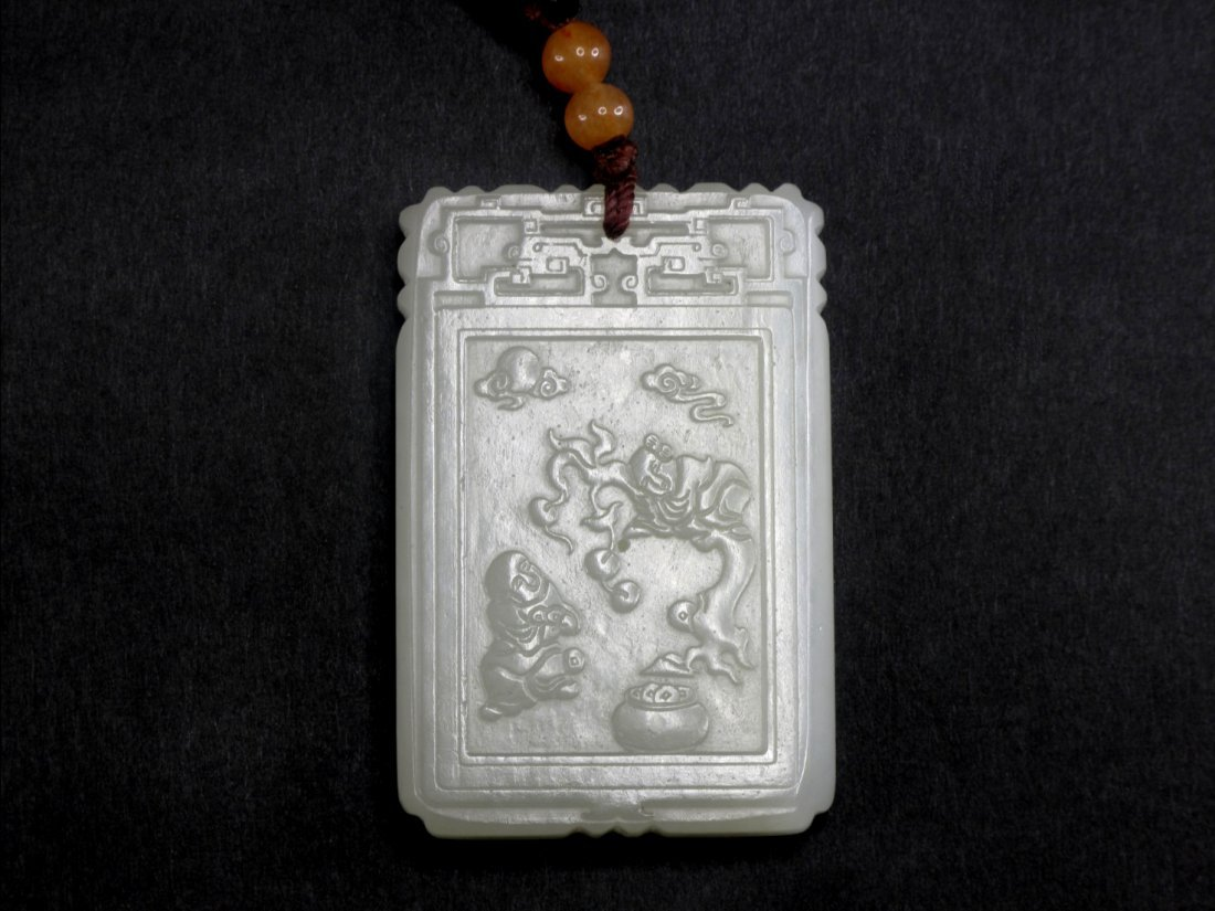 23: A Chinese Fine White Jade Pendant