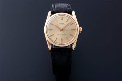 Rolex # 1010 Bombay 14K Yellow Gold Watch