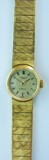 64: 18k Ladies Yellow Gold Patek Philippe Gubelin Watch