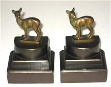 Pair of figural bronze book ends.