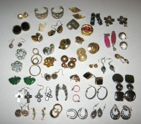 42 pair of jeweled earrings,
