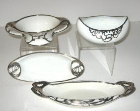 Four white porcelain silver overlay dishes,
