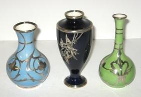 Three silver overlay porcelain vases,