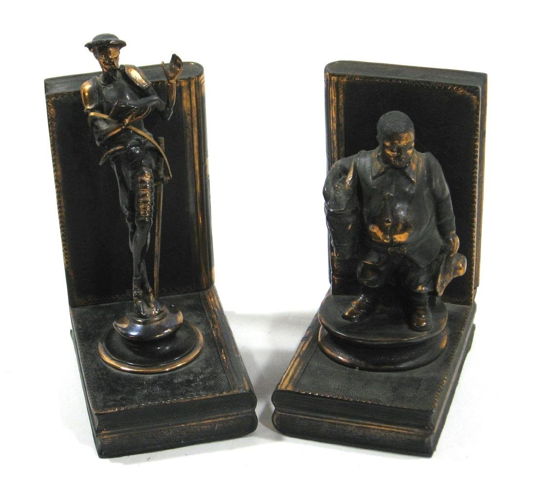 Pair of Bronze book ends,