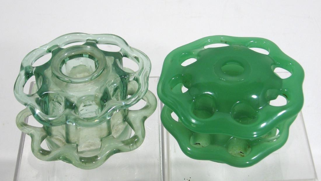 2 Steuben green flower frogs,