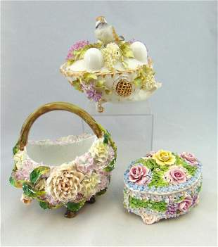 Three ornate flower porcelain items