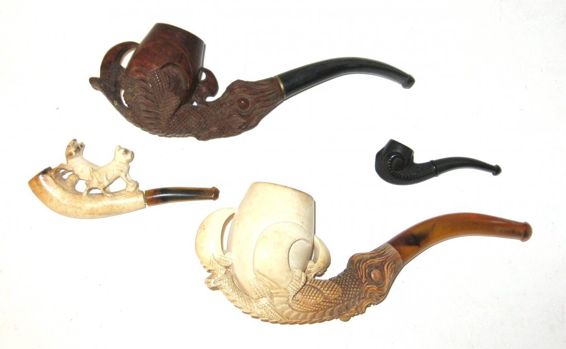 Four Meerschaum and wood pipes,
