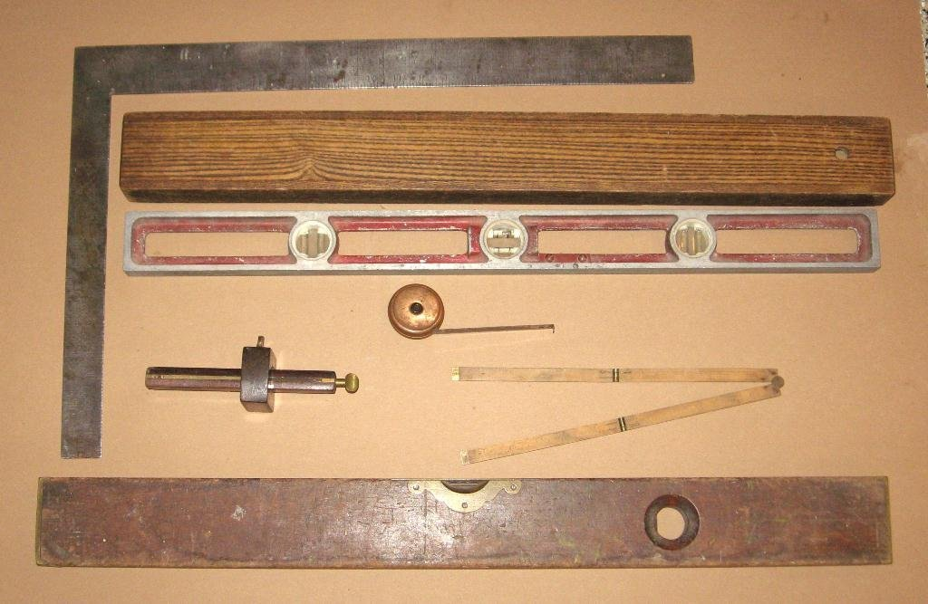 Six old measuring tools,