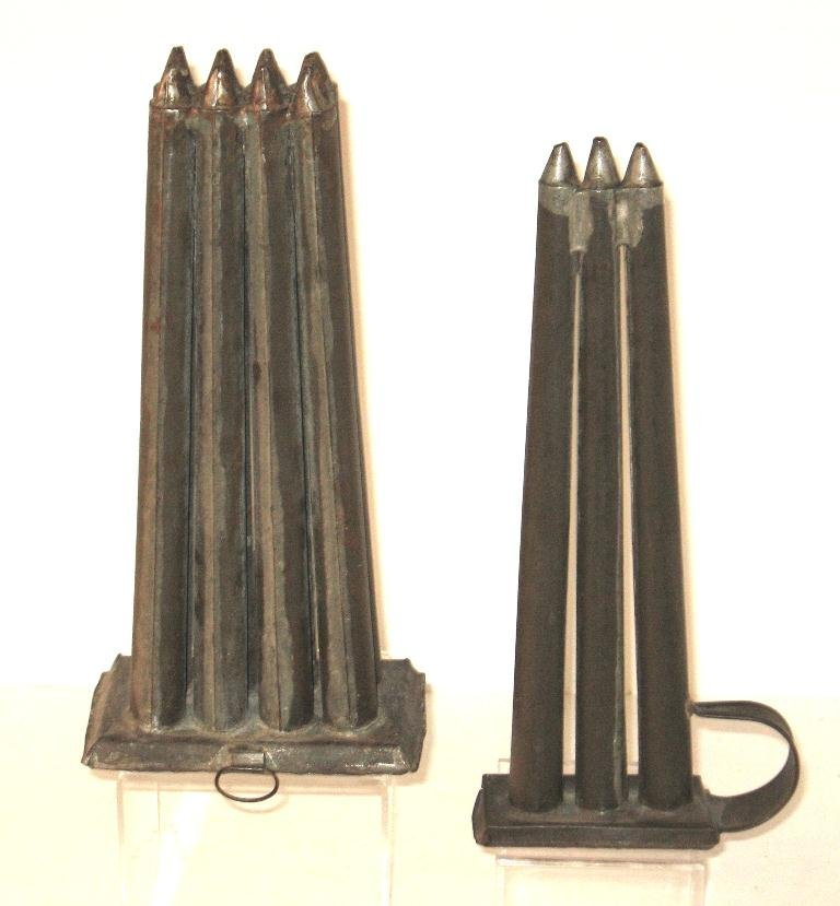 Two 19th century tin candle molds,