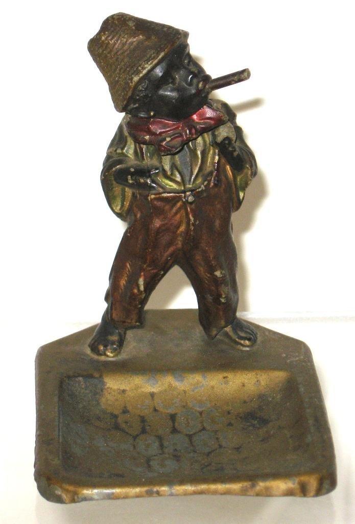 Black memorabilia bobble head bronze,