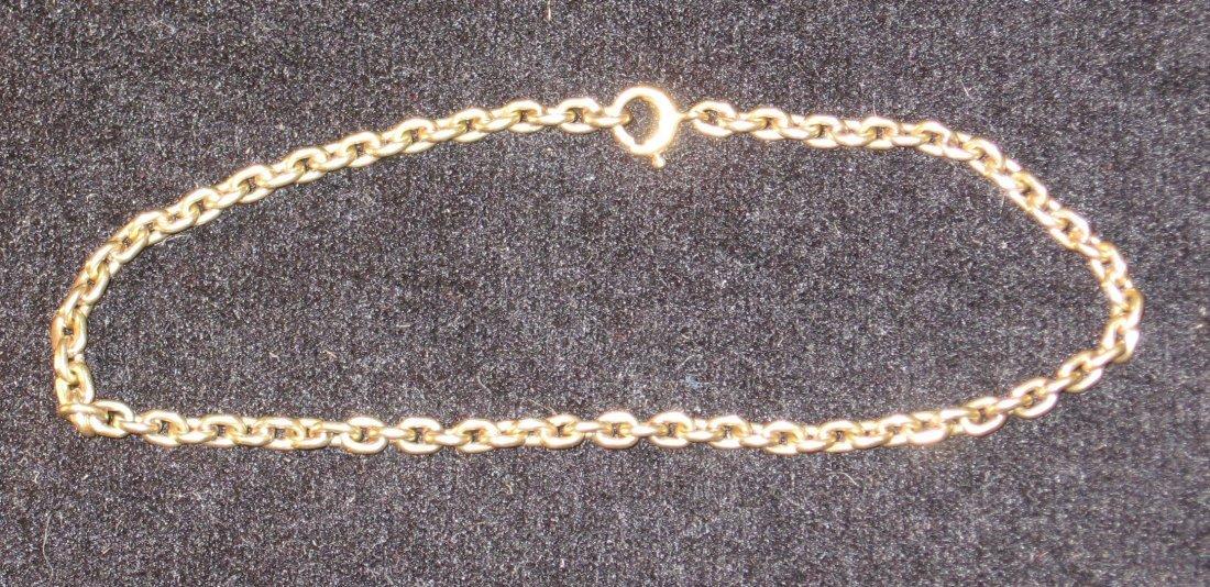14K yellow gold charm bracelet,