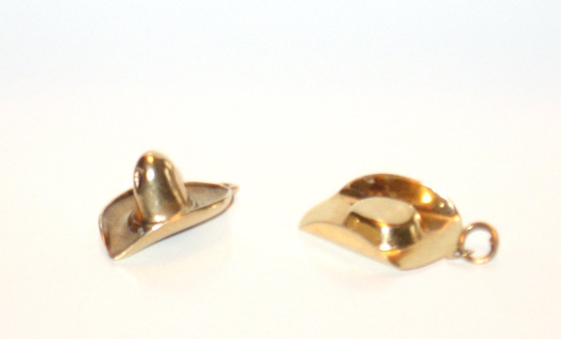Two 14K gold cowboy hat charms,