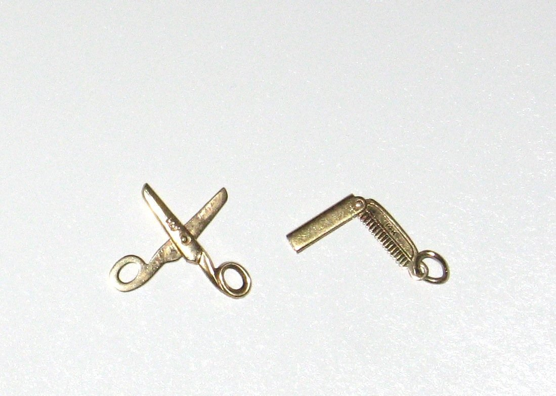 Two 14K gold charms scissors and comb,