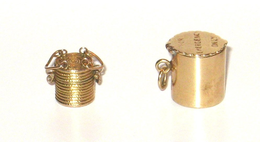 Two 14k gold covered basket/can charms,