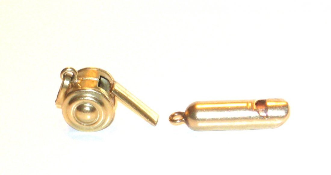 Two 14K gold whistle charms,