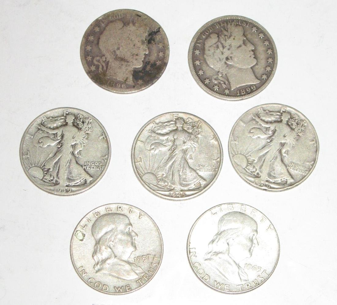 Group of 8 Silver half dollars,