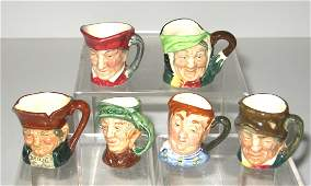 Group of Six diminutive Royal Doulton mugs,