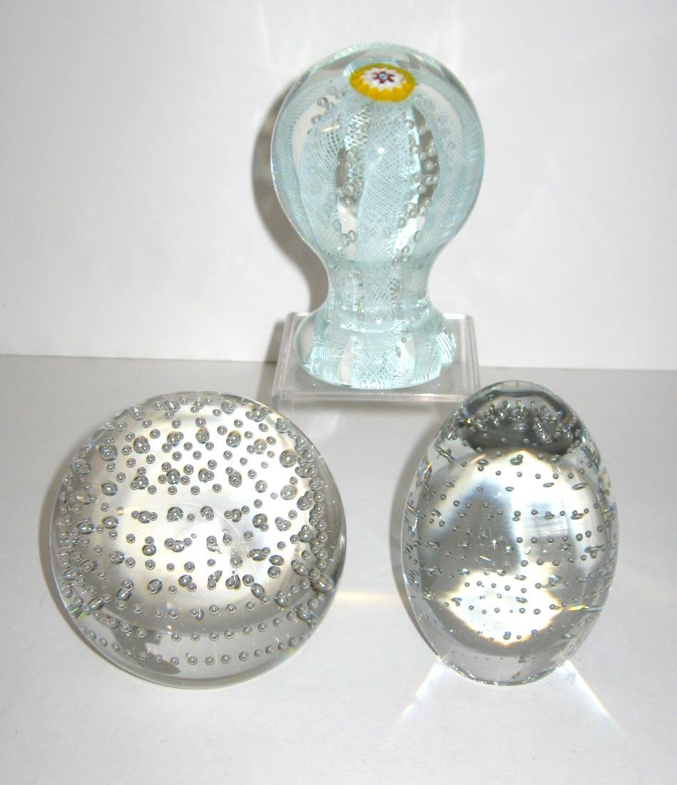 Three glass paperweights,