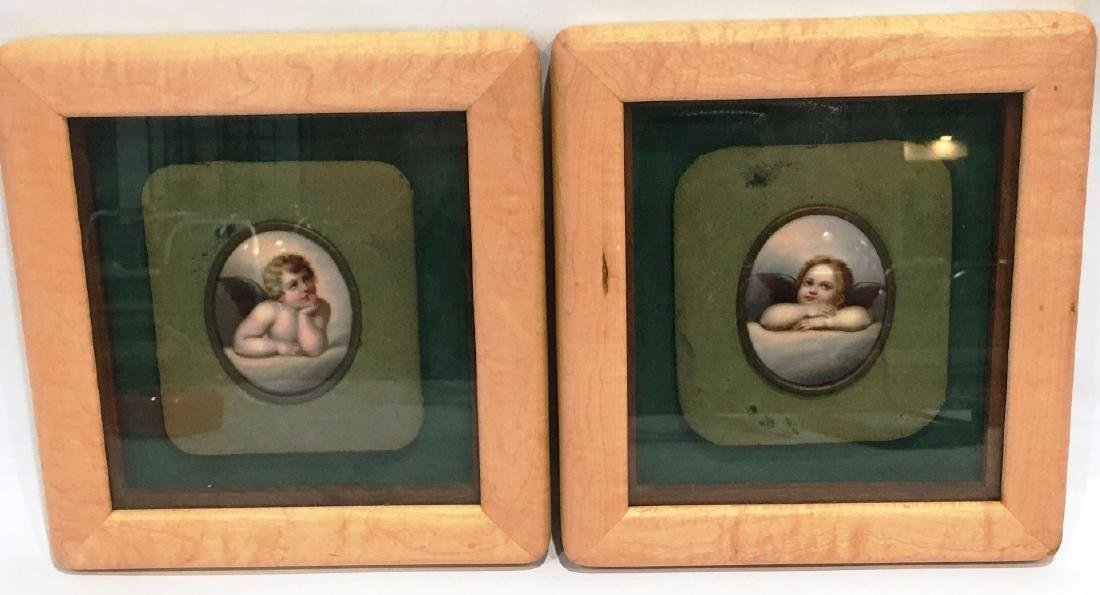 TWO OVAL FRAMED HAND PAINTED CHERUBS