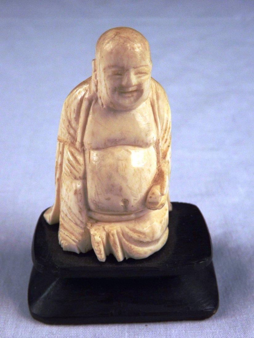 20: Ivory Buddha