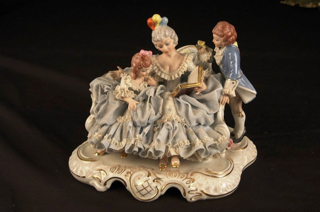 12: Porcelain Woman with Children
