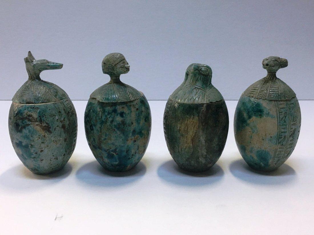 SET OF 4 EGYPTIAN CANOPIC JARS