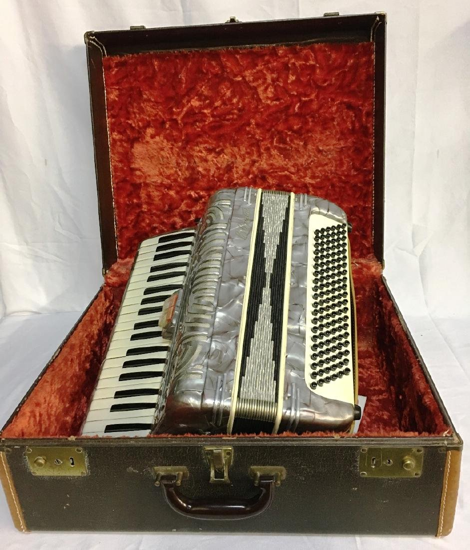 B. BURINI ACCORDION W/ BOX