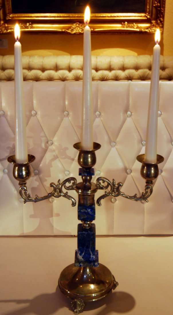 23: Three-pronged candelabra with lapis lazuli items