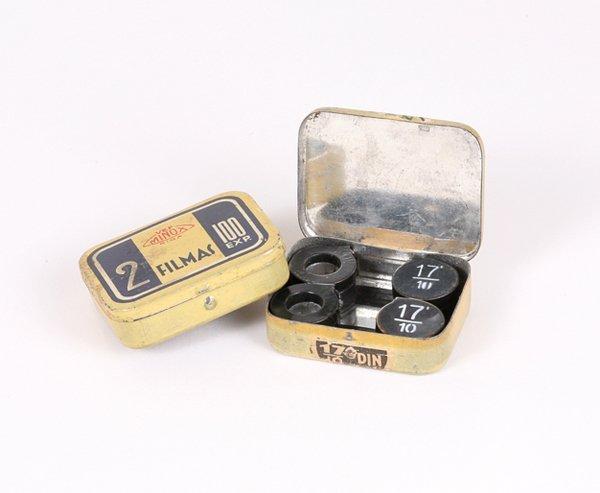 8: Two Minox Film Tins marked Latvia.