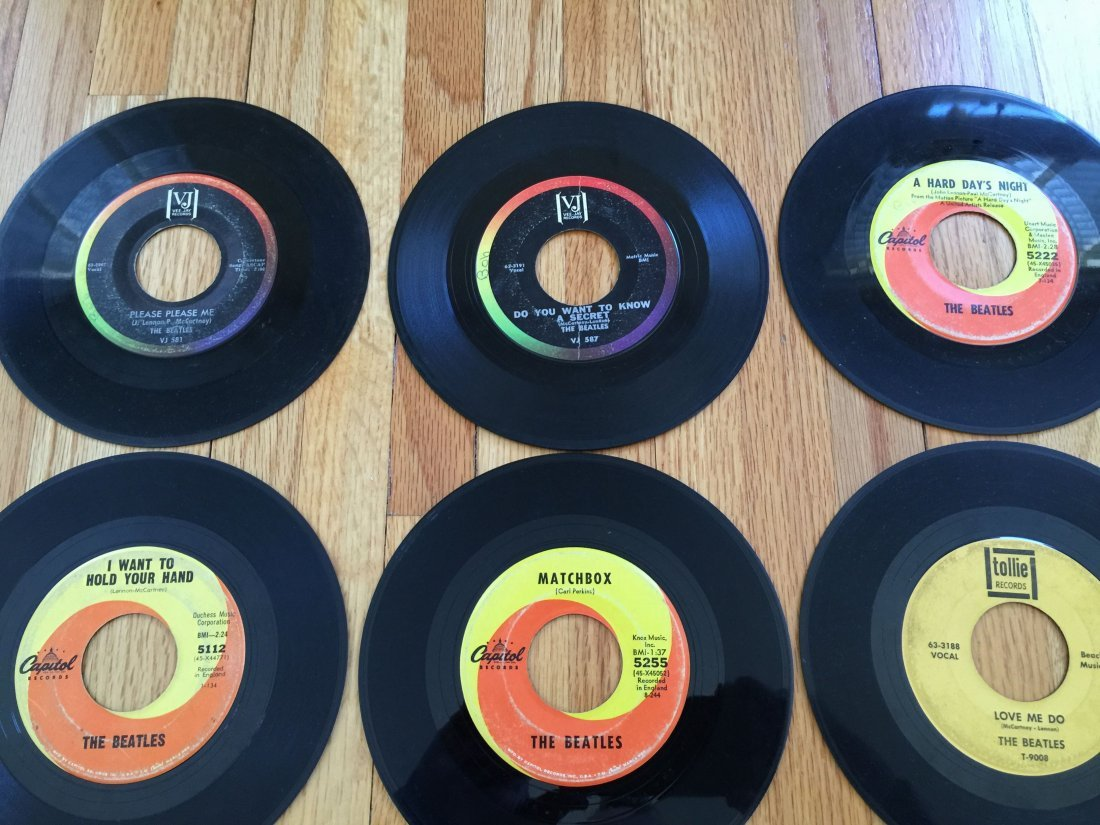 A COLLECTION OF VINTAGE BEATLES 45RPM RECORDS