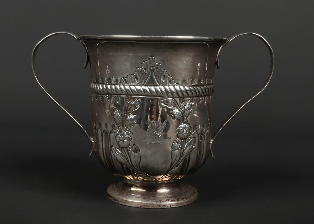 A George III silver cup. With twin reeded strap handles
